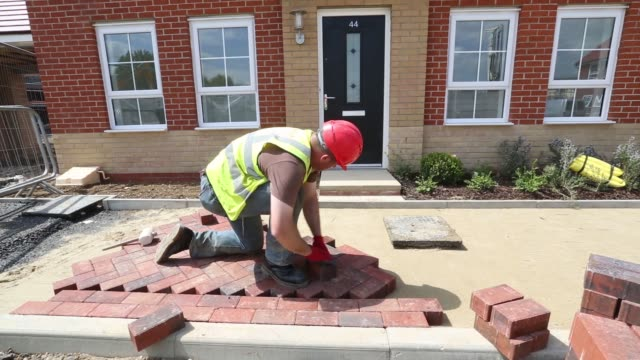 employees work on a new home at a barratt developments plc construction site for residential housing in basildon, uk, on thursday, may 21, 2015 - basildon stock videos & royalty-free footage