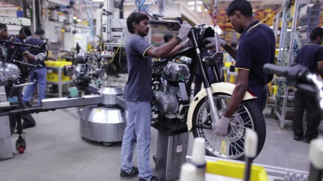 employees work on a royal enfield classic 350 motorcycle on the production line at the eicher motors ltds royal enfield manufacturing facility in... - chennai stock videos & royalty-free footage