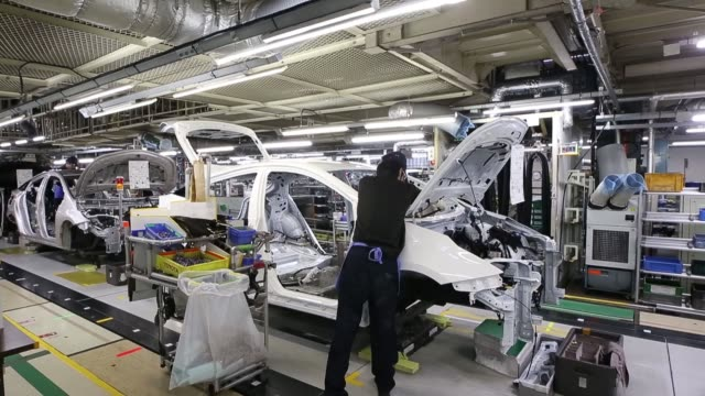 stockvideo's en b-roll-footage met employees work on automobile assembly on the prius hybrid plugin vehicle production line inside the toyota motor corp tsutsumi plant in toyota city... - toyota motor