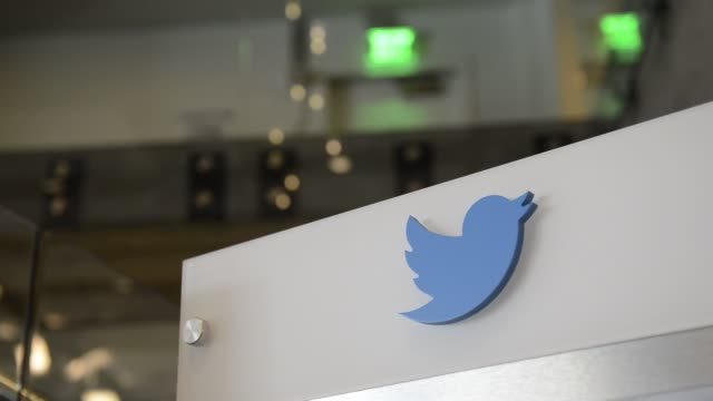 Employees work on projects at Twitter Inc headquarters in San Francisco California Close up shots of a Twitter Logo on a bulletin board in the lobby...