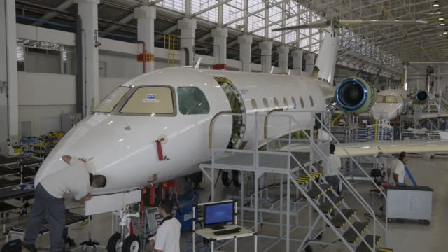 employees work on the assembly line of the model legacy 500 at an embraer plant in sao jose dos campos, state of sao paulo, brazil on wednesday,... - aerospace stock videos & royalty-free footage