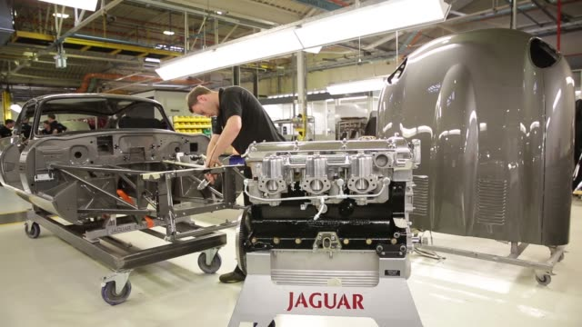 employees work on the assembly stage of rebuilding a jaguar series 1 e-type automobile at the jaguar classic workshop in coventry, uk on wednesday,... - コベントリー点の映像素材/bロール