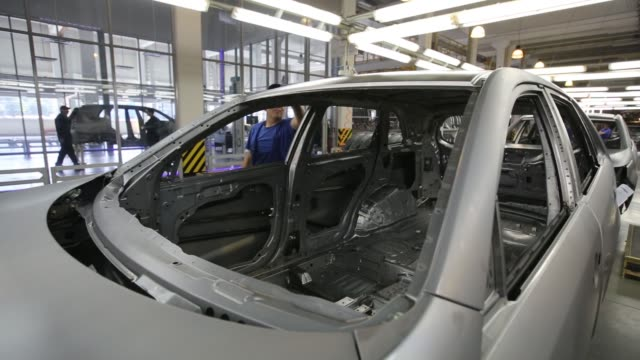employees work on the bodywork of kia motors corp sorento automobiles on the production line at the avtotor auto assembly plant in kaliningrad russia... - bodywork stock videos & royalty-free footage