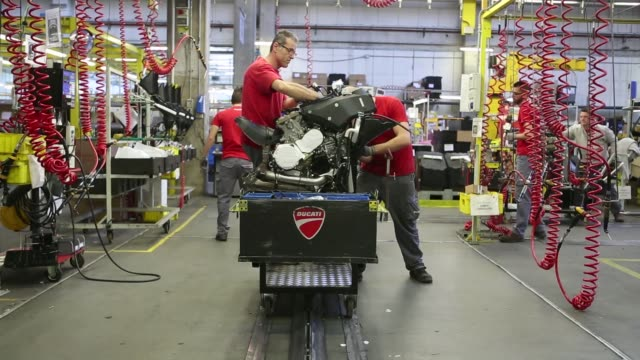 Employees work on the production line for the Ducati Multistrada 1200 motorcycle produced by Ducati Motor Holding SpA a unit of Volkswagen AG at the...