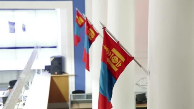 Employees work on the trading floor of the Mongolian Stock Exchange in Ulaanbaatar Mongolia on Tuesday July 19 An employee works on the trading floor...
