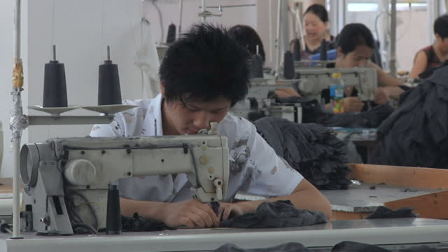 vidéos et rushes de ms employees working at sewing machines in factory / ningbo, zhejiang, china - habillement