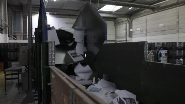 employees working at the company nouvelle attitude responsible for sorting and recycling office paper on november 4 2019 in buc france nouvelle... - annuncio economico video stock e b–roll