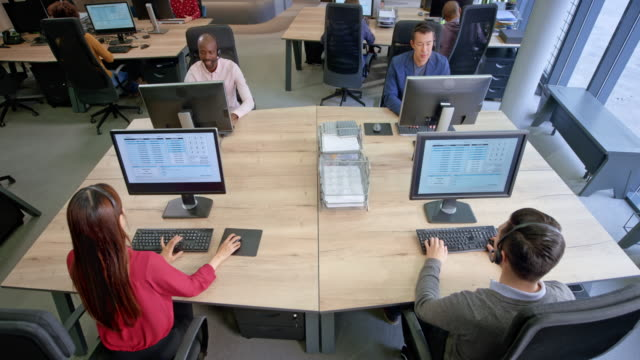cs ld employees working in a modern call centre - 40 44 years stock videos and b-roll footage