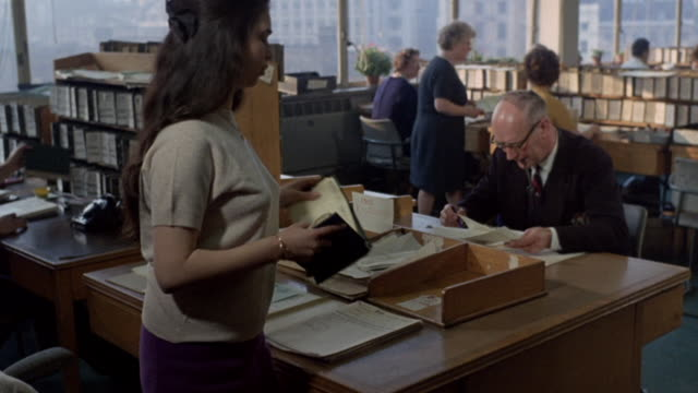 1968 ts employees working in an office / united kingdom - anno 1968 video stock e b–roll