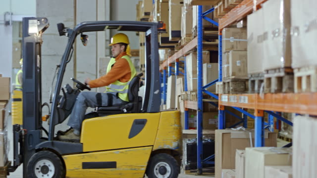 employees working in the warehouse - forklift truck stock videos and b-roll footage