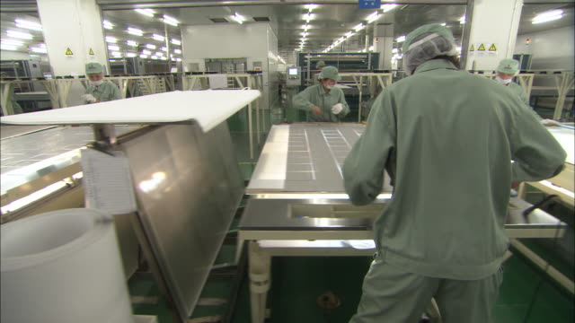 ws ds employees working on solar panels in suntech power holdings factory, wuxi, jiangsu, china - manufacturing occupation stock videos & royalty-free footage