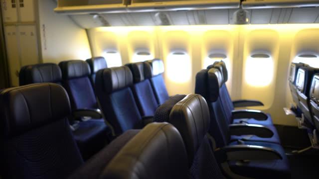 vidéos et rushes de cabine vide de passager d'avion - intérieur de véhicule