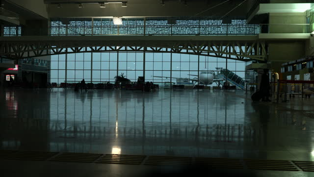 empty airport and aircraft at background, during the covid-19 pandemic - epidemic stock videos & royalty-free footage