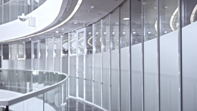 ds empty and bright corporate hallway - safety rail stock videos & royalty-free footage