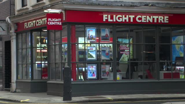 empty and closed flight centre shop as travel is banned during the uk lockdown due to coronavirus pandemic - travel stock videos & royalty-free footage
