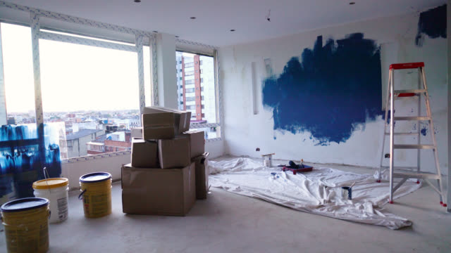 empty apartment during a home renovation process - bricolage video stock e b–roll