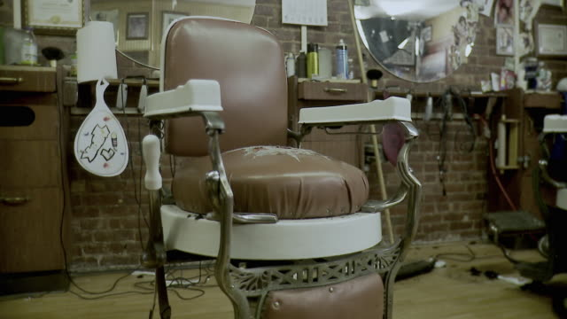 ms empty barber chair in barbershop, brooklyn, new york city, new york state, usa - barber chair stock videos & royalty-free footage