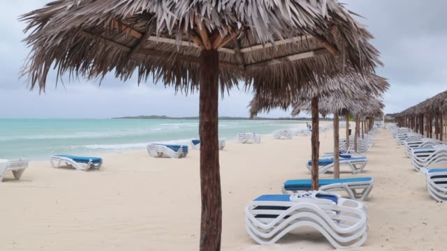 empty beach in cayo coco, cuba after hurricane, storm - palapa stock videos & royalty-free footage