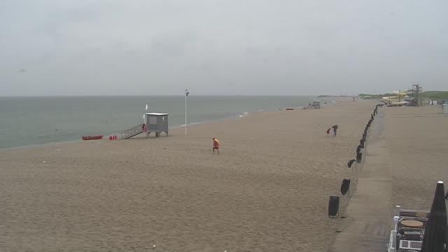 empty beach - lifeguard walking towards post - water slide stock videos & royalty-free footage