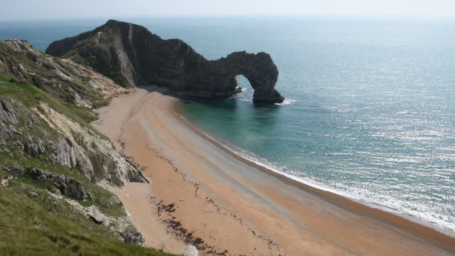 empty beaches on the easter bank holiday weekend due to coronavirus pandemic dorset uk on friday apr 10 2020 - natural arch stock videos & royalty-free footage