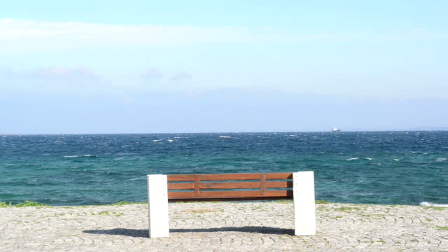 empty bench on the coastline