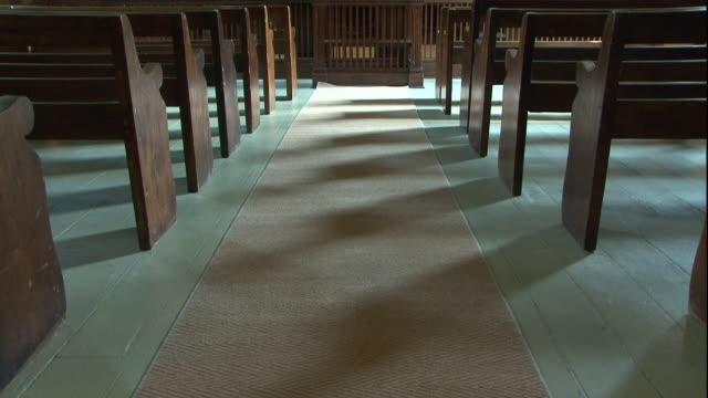 empty benches line a courtroom. - court room stock videos & royalty-free footage