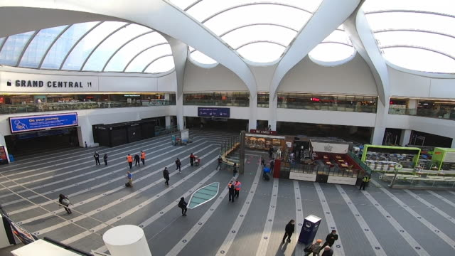 empty birmingham new street station during rush hour as commuters continue to work from home after coronavirus lockdown - station stock videos & royalty-free footage