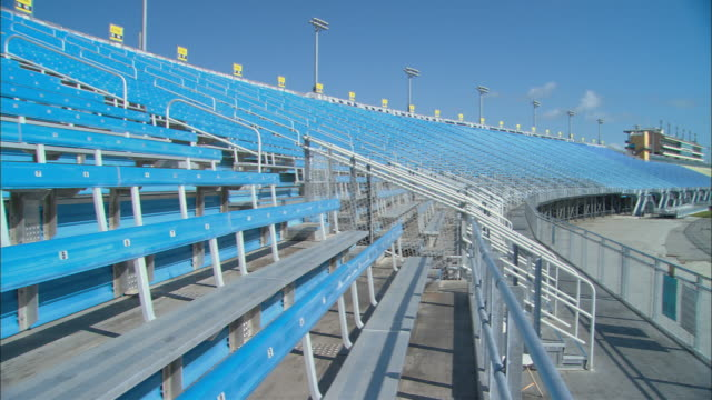 la ws pan tu empty bleachers in sections 191-192 at homestead-miami speedway / homestead, fl, usa - miami dade county stock videos and b-roll footage