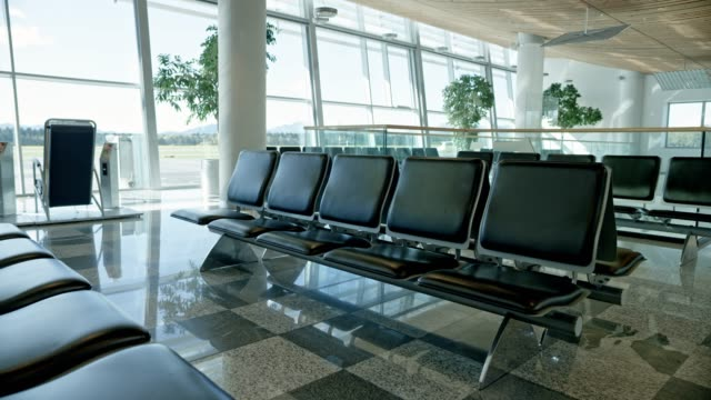 ds empty boarding gate departure lounge at an airport - airport stock videos & royalty-free footage
