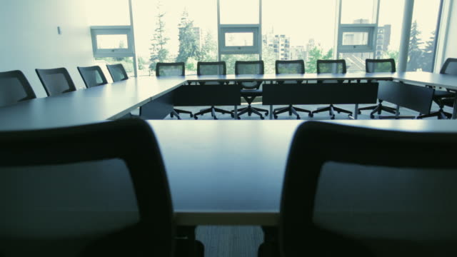 ws pan empty boardroom / vancouver, british columbia, canada - conference table stock videos & royalty-free footage