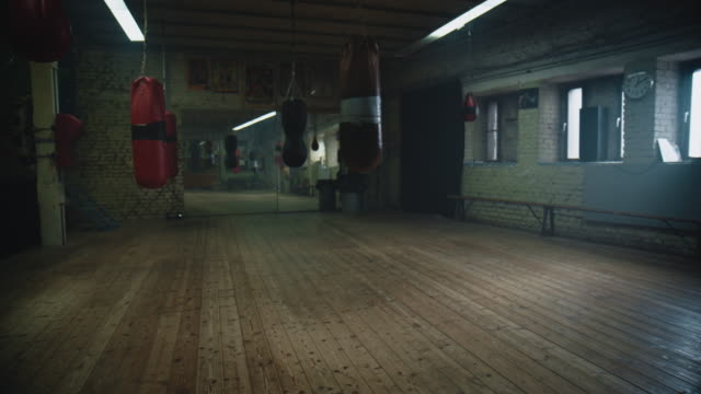 empty boxing gym - punch bag stock videos & royalty-free footage