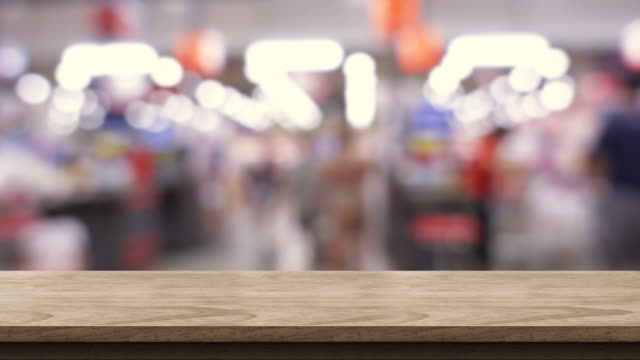 vídeos de stock e filmes b-roll de empty brown wood table and blurred people shopping at supermarket light background. mock up backdrop template for product display.promotion stand. - montagem