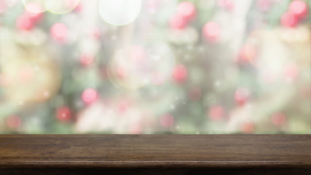 empty brown wood table and snow falling with blur christmas tree bokeh light background,backdrop template for display of product or design,food stand mock up. - wood material stock videos & royalty-free footage