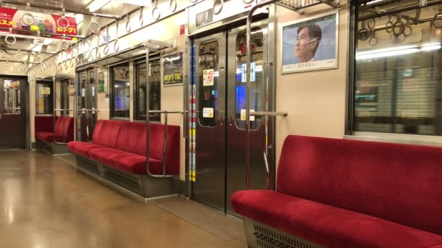 empty carriages are pictured on the tokyu denentoshi line train during the first weekend of the golden week national holiday on may 02 2020 in tokyo... - tokyo japan stock videos & royalty-free footage