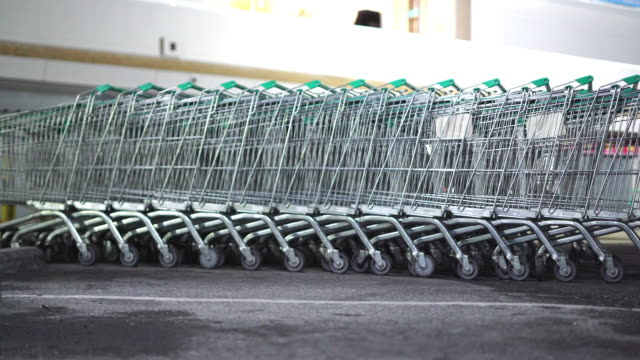 empty cart at supermarket parking in covid-19 situation - wide shot stock videos & royalty-free footage