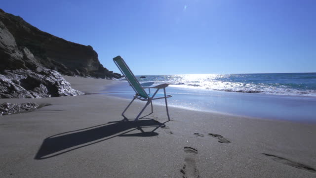 empty chair in a delightful beach with nobody - deck chair stock videos & royalty-free footage
