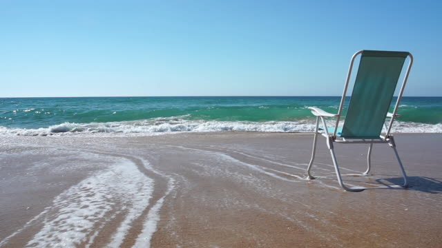 empty chair in a delightful beach with nobody - outdoor chair stock videos and b-roll footage