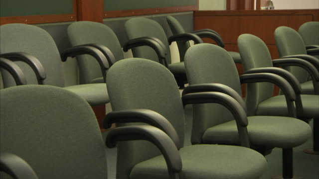 empty chairs fill a courtroom. - legal trial stock videos & royalty-free footage