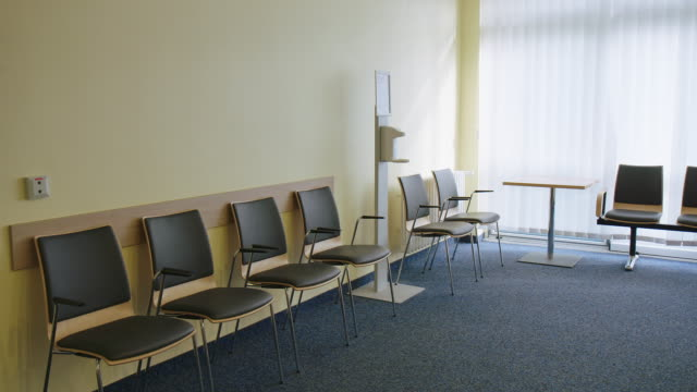 empty chairs in waiting room at hospital - waiting room stock videos & royalty-free footage