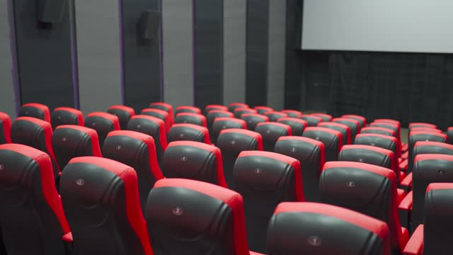 empty cinema with blank white screen - premiere stock videos & royalty-free footage