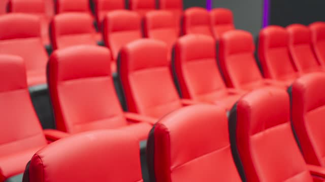 empty cinema with rows red colour seat - premiere stock videos & royalty-free footage