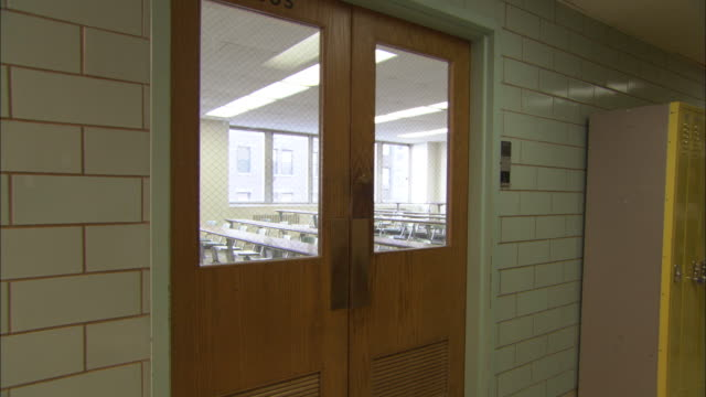 MS Empty classroom through door, Brooklyn, New York City, USA