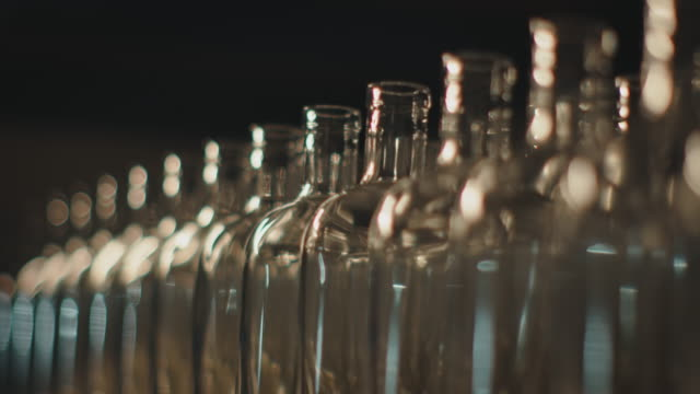 empty clean bottles arranged side by side - side by side stock videos & royalty-free footage