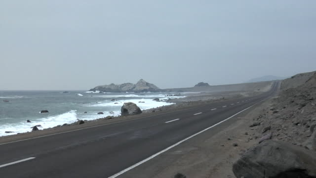 ws empty coast road, iquique, chile - empty road stock videos and b-roll footage