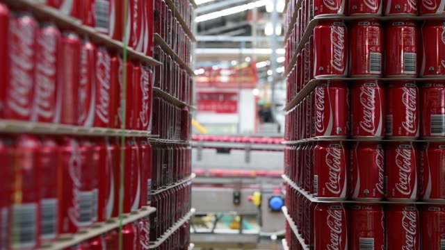 empty cocacola classic cans are stacked at a cocacola amatil ltd production facility in melbourne australia on tuesday feb 16 empty cocacola life... - cola stock videos & royalty-free footage