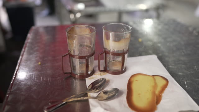 empty coffee cups on a table outside a cafe - notting hill videos stock videos & royalty-free footage