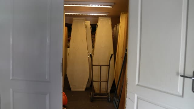 empty coffins at a temporary covid19 mortuary run by east london mosque at a railway arch in tower hamlets east london gv's of refrigerated space at... - metal stock videos & royalty-free footage