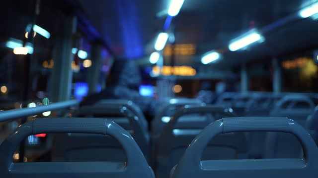 empty commuter bus, inside view of bus moving at night - indoors stock videos & royalty-free footage