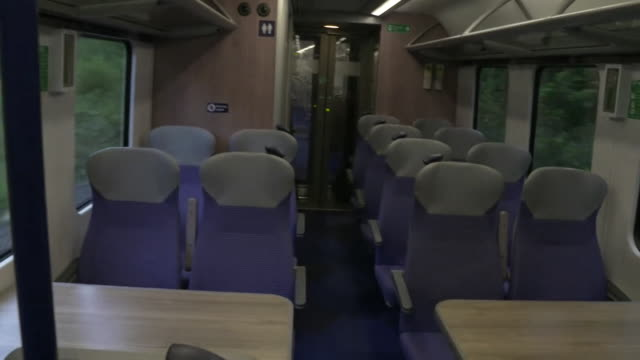 empty commuter train from huddersfield to manchester during the coronavirus pandemic - teleworking stock videos & royalty-free footage