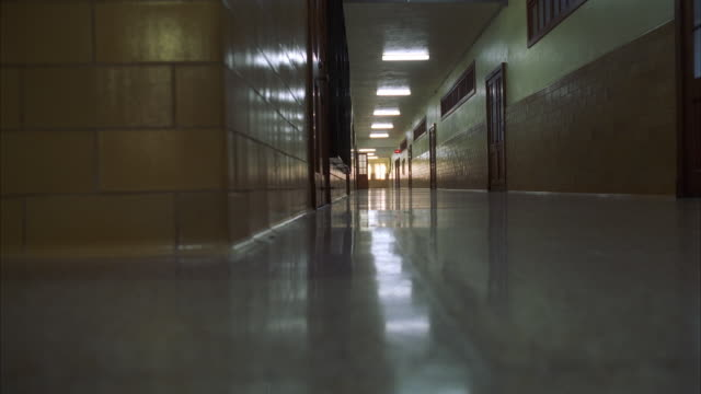 WS LA Empty corridor with lamps reflecting on floor